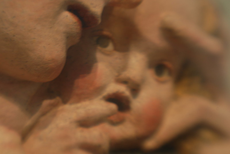 pensive baby sculpture from the Louvre